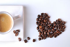 Heart with grains and coffee cup Royalty Free Stock Photo