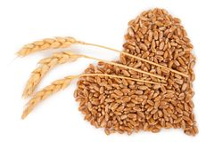 Heart of grains of wheat with spikelet Royalty Free Stock Photos
