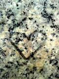 Heart on Granite Rock. Symbols and messages of love can be found in the most unexpected places including on granite rock. Is it a strong love for the granite? Stock Image