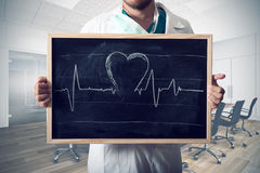 Heart graph. Doctor show heart graph in a blackboard Royalty Free Stock Image