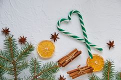 Heart of green candy cones with spices for mulled wine - anise stars, dried oranges, cinnamon sticks with free copy space royalty free stock image