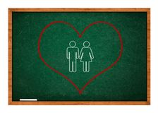 Heart on green chalkboard Stock Photos