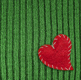 Heart on green knitted wool background. Red heart on green knitted wool background Royalty Free Stock Photography