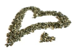 Heart from green tea. Isolated on a white background Stock Photo