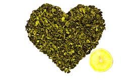 The heart of the green tea with lemon Stock Photos