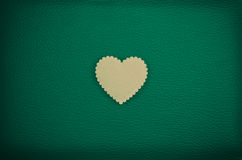 Heart on green vintage leather background Stock Image