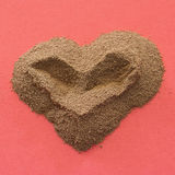 Heart from ground coffee Royalty Free Stock Images