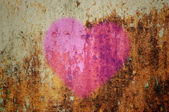 Heart on grunge wall. Pink heart on grunge wall Royalty Free Stock Photography