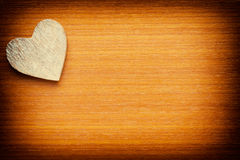 Heart on a grunge wooden background Stock Photo