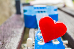 Heart on the guitar Stock Photography