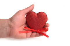 Heart in hand. Photograph of a hand holding a heart,shot in studio and isolated on white Royalty Free Stock Image