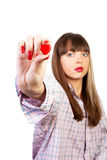 Heart in hand. Young woman holding a red heart in an outstretched arm royalty free stock photos