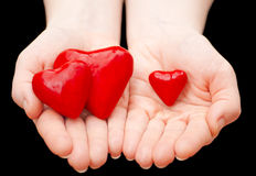 Heart in hand. Plasticine heart in hand on a black background Royalty Free Stock Image