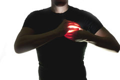 Heart in hand. Silhouette of man holding a luminous heart Royalty Free Stock Photos