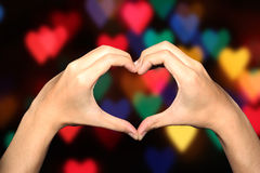 Heart hand clipping paths bokeh. Make my hand like heart with hearts bokeh Royalty Free Stock Photos