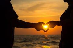 Heart hand of couple Stock Photos