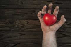 Heart in hand. gloomy background. Concept of medicine, saving lives, donor. Place for text stock photo
