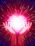 Heart Hand Light Beam Magic Power Love Background Red. Heart in open hands with glowing beams; Symbol of amour illuminate around the power of love; Background Royalty Free Stock Photos