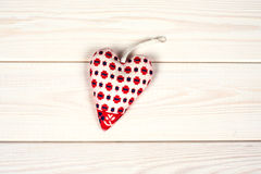 Heart  hand made on a wooden background. Heart symbol  hand made on a wooden background Stock Image