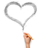 Heart and hand with pencil. Isolated on white background Stock Images