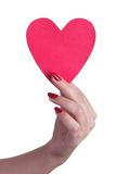 Heart in the hand. Pink paper heart holds a woman's hand Royalty Free Stock Images