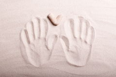 Heart and hand prints in the sand. Heart and hand prints in sand stock photo