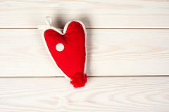 Heart handmade as a symbol of love. On a wooden background Royalty Free Stock Photos