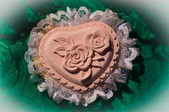 Heart handmade decoration with a rose in the middle and lace aro Royalty Free Stock Photos