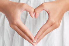 Heart by hands Royalty Free Stock Images
