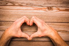 Heart in hands on  day in love. A happy valentine`s day in love and heart hands royalty free stock photo