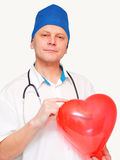 Heart in the hands of a doctor. Heart in the hands of a doctor insulated on white Royalty Free Stock Photos