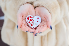 Heart in the hands of a girl Stock Photo