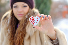 Heart in the hands of a girl in winter Stock Photography