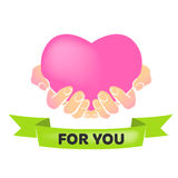Heart in hands. Inscription on ribbon: for you Royalty Free Stock Photo