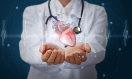 Heart in the hands of the medical worker . Heart in the hands of the medical worker on blue background royalty free stock photos