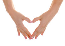 Heart by hands with nice manicure. Female hands with nice french manicure show heart Royalty Free Stock Images
