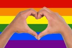 Heart of hands on a rainbow flag Royalty Free Stock Photos