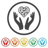 Heart in hands sign icon, Donation icon, 6 Colors Included. Simple vector icons set Royalty Free Stock Photography