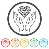 Heart in hands sign icon, Donation icon, 6 Colors Included. Simple vector icons set Stock Image