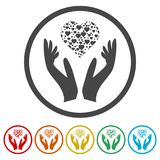 Heart in hands sign icon, Donation icon, 6 Colors Included. Simple vector icons set Royalty Free Stock Images
