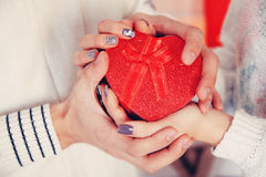 Heart in hands, tinted Stock Photography