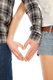 Young couple showing heart with fingers isolated over white background Royalty Free Stock Photography