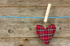 Heart hang  over a wooden background Royalty Free Stock Images