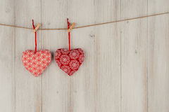 Heart hanging on the clothesline. On old wood background Stock Photos