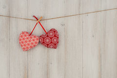 Heart hanging on the clothesline. On old wood background Royalty Free Stock Photos