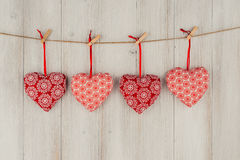 Heart hanging on the clothesline. On old wood background Stock Photography