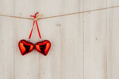 Heart hanging on the clothesline. On old wood background Royalty Free Stock Image