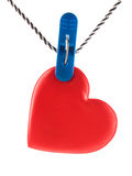 Heart hanging on clothespins on a rope Stock Photo