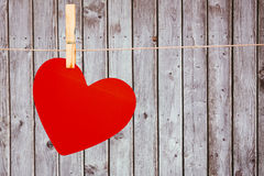 A heart hanging on a line Royalty Free Stock Photography
