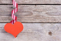 Heart hanging from ribbon Royalty Free Stock Images